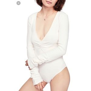 NWT Free people cozy me up cream bodysuit